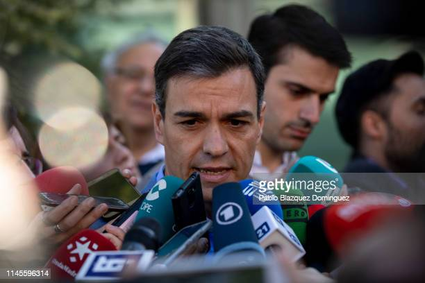 Spain's Prime Minister and Spanish Socialist Workers' Party leader Pedro Sanchez speaks to the press after casting his vote at a polling station...