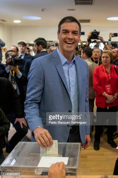 Spain's Prime Minister and Spanish Socialist Workers' Party leader Pedro Sanchez poses for photographers as he cast his vote at a polling station...