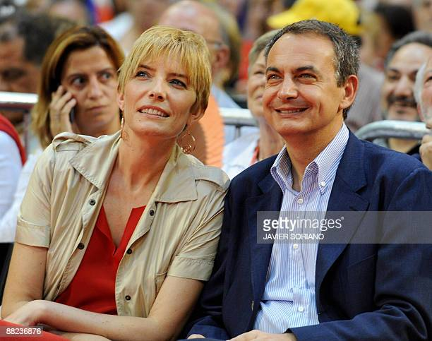 Spain's Prime Minister Jose Luis Rodriguez Zapatero and his wife Sonsoles Espinosa smile during the Socialist Party's campaign for the upcoming...