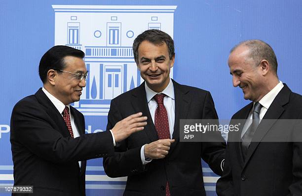 Spain's Prime Minister Jose Luis Rodriguez Zapatero Chinese ExecutiveVice Premier Li Keqiang and Spanish Minister of Industry Miguel Sebastian smile...