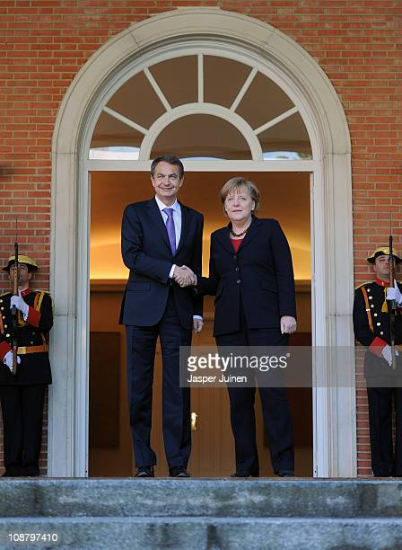 Spain's Prime Minister Jose Luis Rodriguez Zapatero greets German Chancellor Angela Merkel upon her arrival at La Moncloa Palace on February 3 2011...