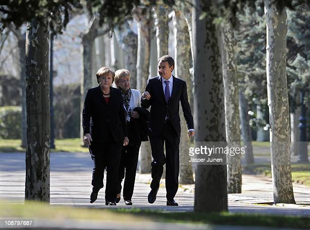 Spain's Prime Minister Jose Luis Rodriguez Zapatero talks with German Chancellor Angela Merkel while they walk the gardens of La Moncloa Palace on...