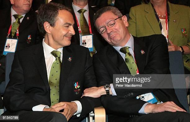 Spain's Prime Minister Jose Luis Zapatero is consoled by Madrid Mayor Alberto Ruiz Gallardon after Rio De Janeiro won the vote to stage the 2016...