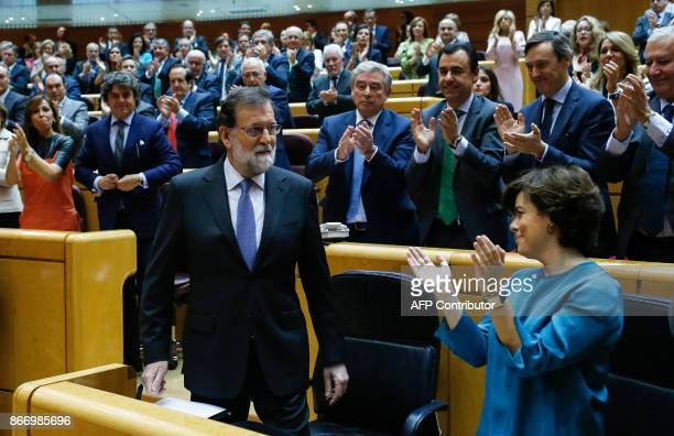 TOPSHOT Spain's Prime Minister Mariano Rajoy acknowledges applause during a session of the Upper House of Parliament in Madrid on October 27 2017 The...