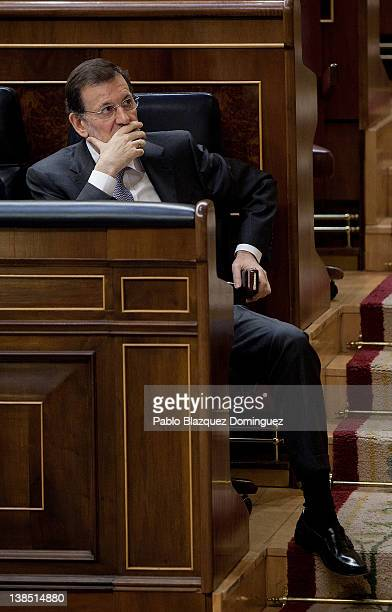Spain's Prime Minister Mariano Rajoy attends a plenary session of Madrid's Parliament on February 8 2012 in Madrid Mariano Rajoy attended Parliament...