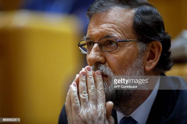 Spain's Prime Minister Mariano Rajoy attends a session of the Upper House of Parliament in Madrid on October 27 2017 Spanish Prime Minister Mariano...