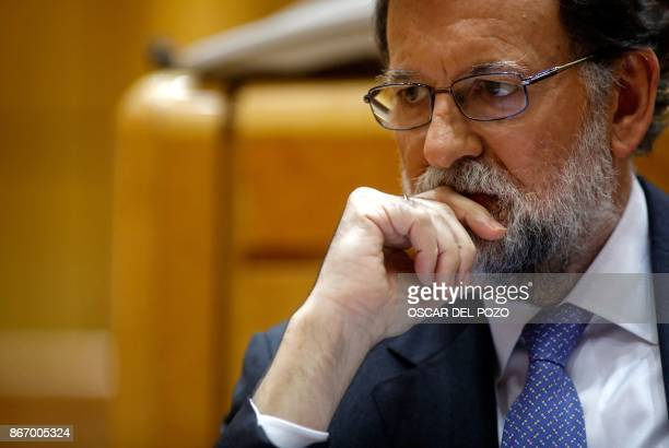 Spain's Prime Minister Mariano Rajoy attends a session of the Upper House of Parliament in Madrid on October 27 2017 The central government has...