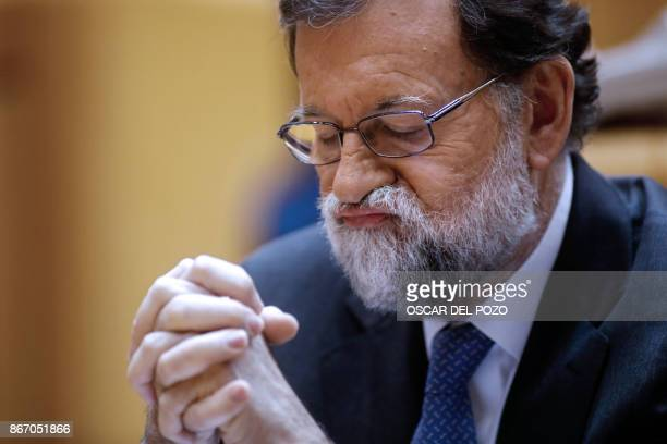 TOPSHOT Spain's Prime Minister Mariano Rajoy gestures as he attends a session of the Upper House of Parliament in Madrid on October 27 2017 The...