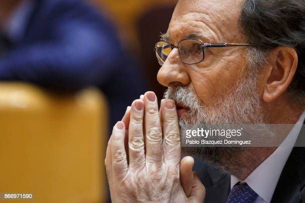 Spain's Prime Minister Mariano Rajoy gestures during a plenary session to approve article 155 of the Spanish Constitution at the Spanish Senate on...