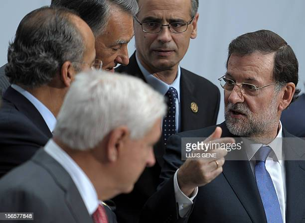 Spain's Prime Minister Mariano Rajoy gestures prior to posing for a family photo as part of the XXII Ibero-American Summit in Cadiz on November 17,...