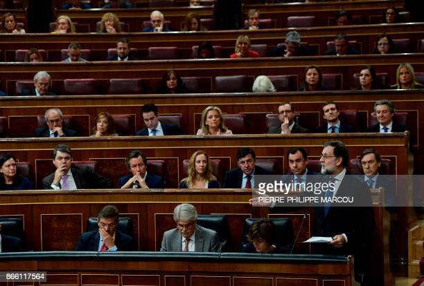 TOPSHOT Spain's Prime Minister Mariano Rajoy gives a speech during a session of the Lower House of Parliament in Madrid on October 25 2017 Spain...