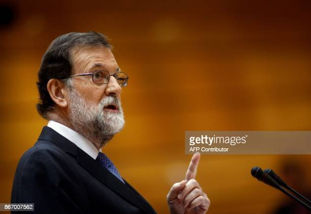 Spain's Prime Minister Mariano Rajoy gives a speech during a session of the Upper House of Parliament in Madrid on October 27 2017 The central...
