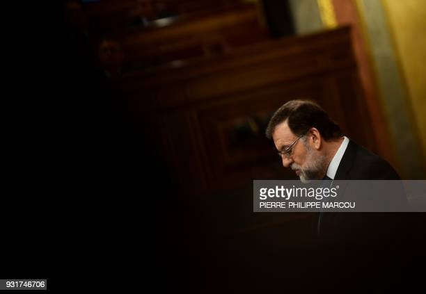 TOPSHOT Spain's Prime Minister Mariano Rajoy gives a speech during a session at the Lower House of Parliament in Madrid on March 14 2018 / AFP PHOTO...