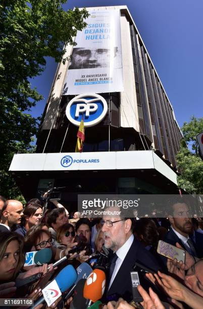 Spain's Prime Minister Mariano Rajoy speaks with journalists after attending a tribute to the Basque PP councillor Miguel Angel Blanco who was...