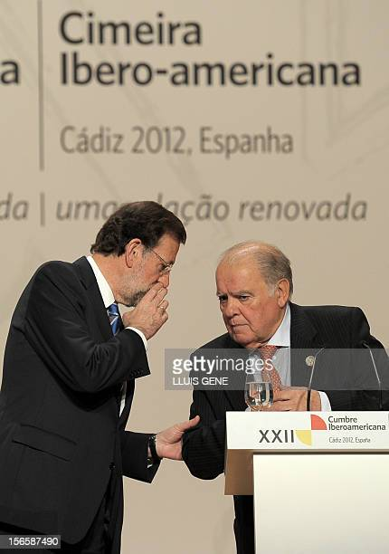 Spain's Prime Minister Mariano Rajoy speaks with Secretary-General of the Ibero-American Secretariat Enrique Iglesias as they give a press conference...