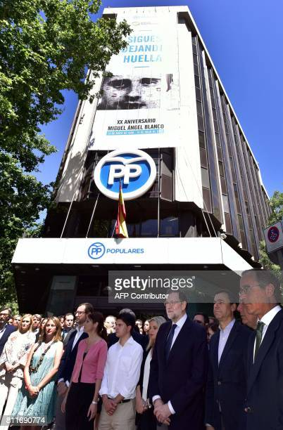 Spain's Prime Minister Mariano Rajoy with other members of the Popular Party and relatives of Basque PP councillor Miguel Angel Blanco pay tribute to...
