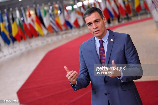 Spain's Prime Minister Pedro Sanchez addresses journalists as he arrives at the EU headquarters' Europa building in Brussels on December 10 prior to...