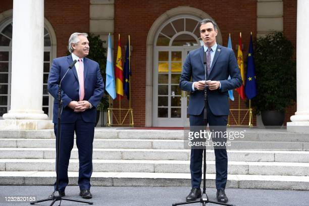 Spain's Prime Minister Pedro Sanchez and Argentine President Alberto Fernandez talk to the press outside the Moncloa Palace in Madrid on May 11, 2021.