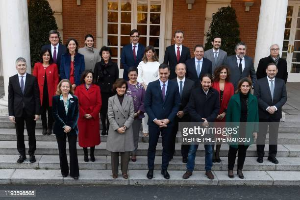 Spain's Prime Minister Pedro Sanchez poses for a family picture with ministers of his coalition government Spain's Deputy Prime Minister of Economic...