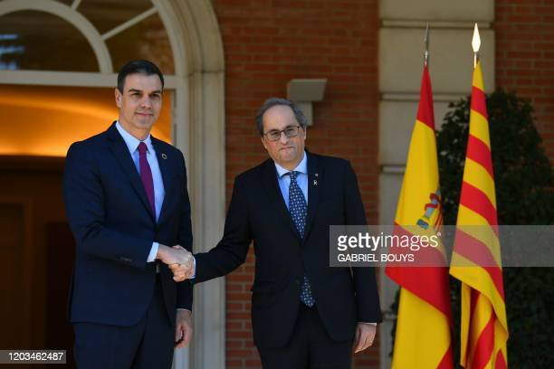 Spain's Prime Minister Pedro Sanchez welcomes Catalonia's regional president Quim Torra at the Moncloa Palace in Madrid on February 26 to open a...