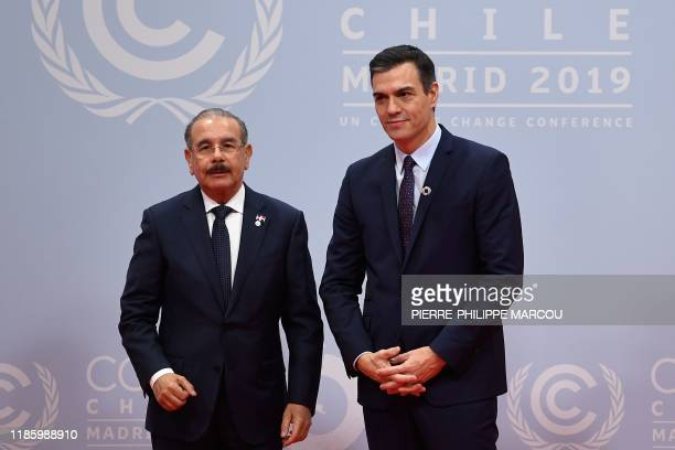 Spain's Prime Minister Pedro Sanchez welcomes Dominican Republic's President Danilo Medina at the UN Climate Change Conference COP25 at the 'IFEMA...