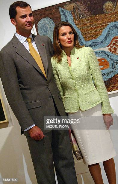 Spain's Prince Felipe and his wife Letizia are pictured at the exhibition of surrealist painter Eugenio Granell during their private visit to...