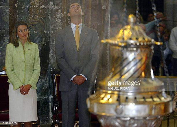 Spain's Prince Felipe and his wife Letizia are pictured next the 'Botafumeiro' a huge thurible during a religious ceremony in the Cathedral of...