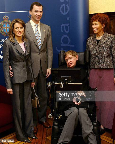 Spain's Prince Felipe and his wife Letizia Ortiz pose with British scientist Stephem Hawking and his wife Elaine in Oviedo 12 April 2005 AFP PHOTO/...
