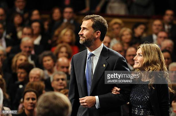 Spain's Prince Felipe and his wife Princess Letizia arrive for the presentation of the 2009 Prince of Asturias Awards at the Campoamor Theater in...