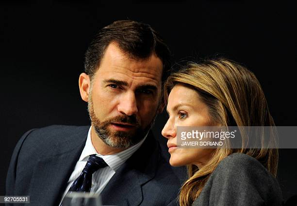 Spain's Prince Felipe and his wife Princess Letizia chat during the opening of the 31th International Conference for Data Protection and Privacy...
