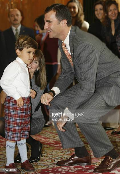 Spain's Prince Felipe and Princess Letizia greet an autistic boy while in Oviedo, 25 October 2007. As patron of the Asturias foundation, Spain's...
