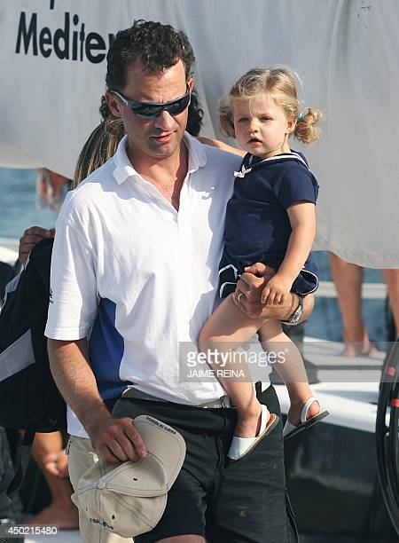 Spain's Prince Felipe carries his daughter Leonor during the Copa del Rey regatta off the coast of Palma de Mallorca on August 3 2007 Like many...