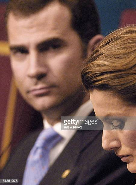 Spain's Prince Felipe de Borbon looks at his wife Princess Letizia during the 2004 Prince of Asturias Awards Ceremony 22 October 2004 in the northern...