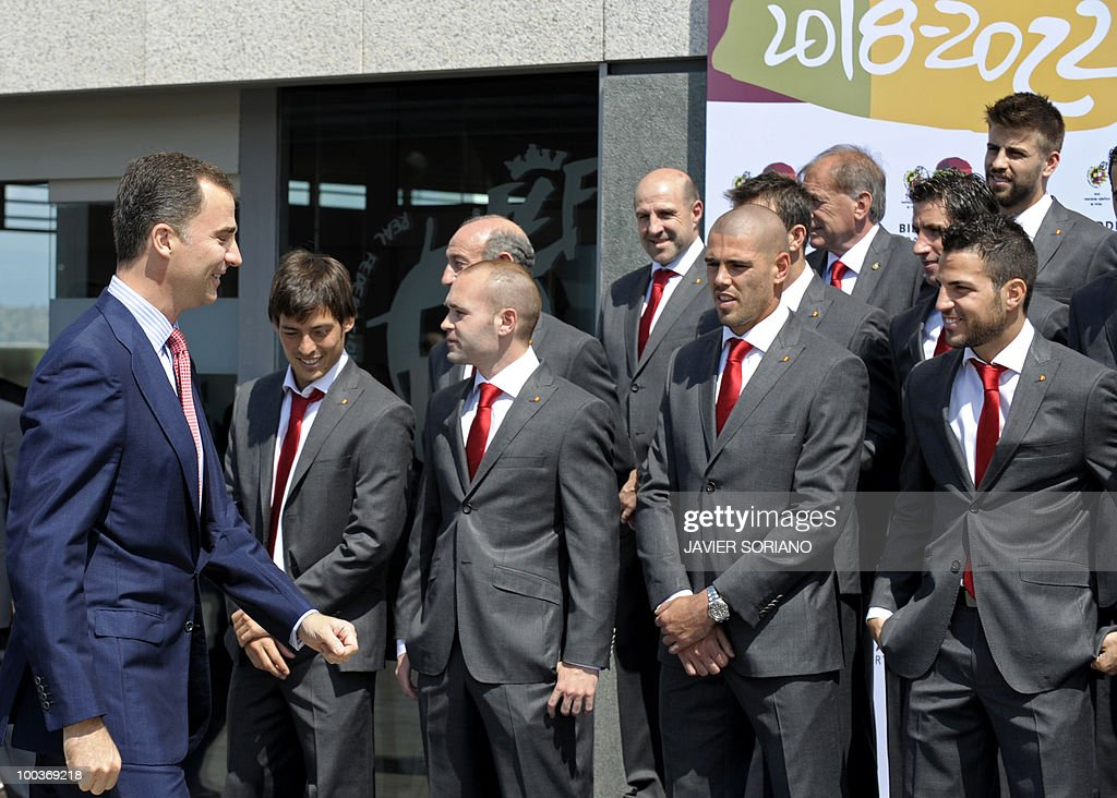Spain's Prince Felipe (L) gathers for a group picture with the Spanish football team during the inauguration of RFEF museum on May 24, 2010 at the Sports City of Las Rozas, near Madrid. Spain, among the favourites for the World Cup, which runs from June 11-July 11, face Switzerland, Honduras and Chile in Group H of the opening round.