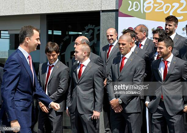 Spain's Prince Felipe gathers for a group picture with the Spanish football team during the inauguration of RFEF museum on May 24 2010 at the Sports...