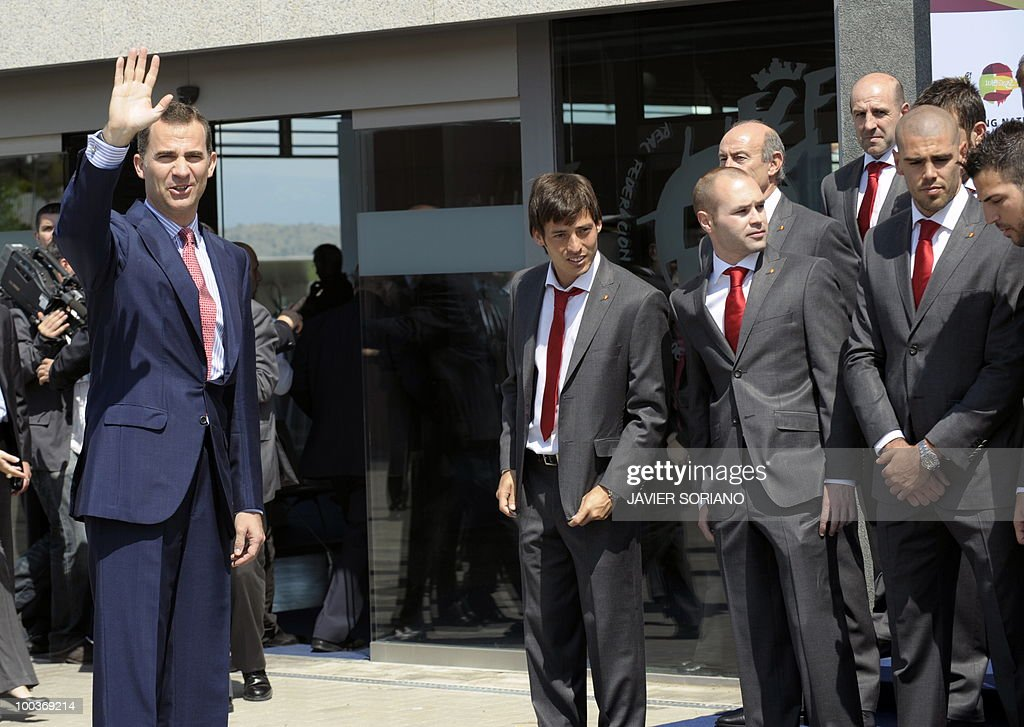 Spain's Prince Felipe (L) waves after a group picture with the Spanish football team during the inauguration of RFEF museum on May 24, 2010 at the Sports City of Las Rozas, near Madrid. Spain, among the favourites for the World Cup, which runs from June 11-July 11, face Switzerland, Honduras and Chile in Group H of the opening round.