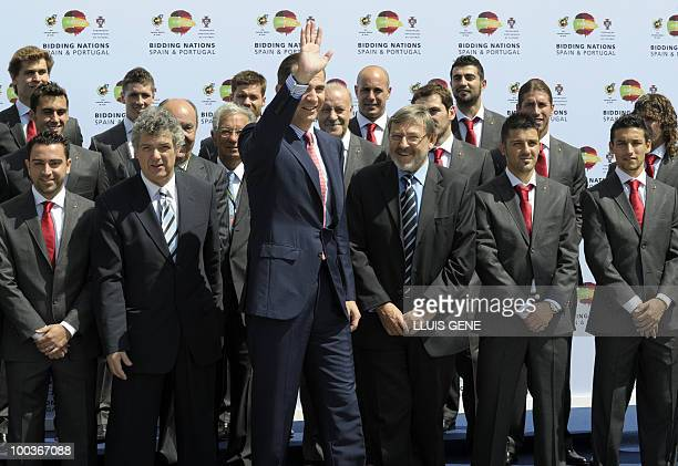 Spain's Prince Felipe waves beroe posing with the Spanish football team on May 24 at the Sports City of Las Rozas near Madrid Spain among the...