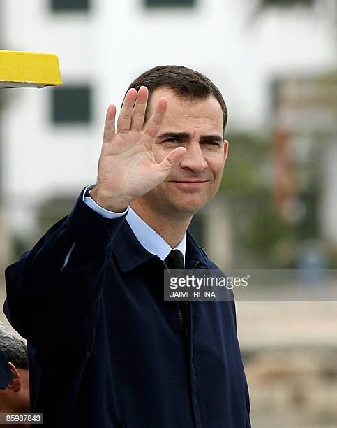 Spain's Prince Felipe waves to onlookers during a simulated sea rescue operation at the Military Base of Pollensa on Mallorca Island on April 15 2009...