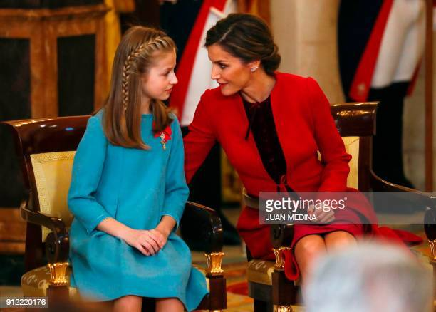 Spain's Princess Leonor is greeted by her mother Queen Letizia after she was awarded with Spain's most prestigious awards the Order of the Golden...