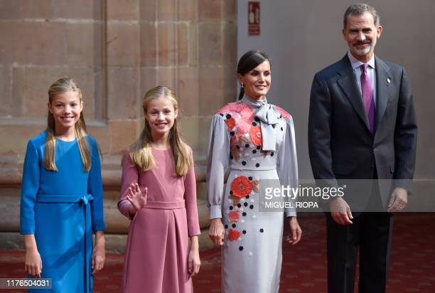 Spain's Princess Leonor waves as she poses with King Felipe VI , Queen Letizia and Princess Sofia at the Reconquinta Hotel in Oviedo, on October 18,...