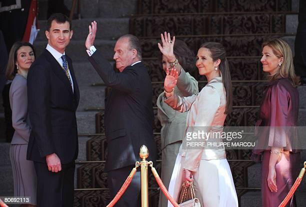 Spain's Princess Letizia Prince Felipe King Juan Carlos Queen Sofia Princess Elena and Princess Cristina waves to the crowds outside parliament in...