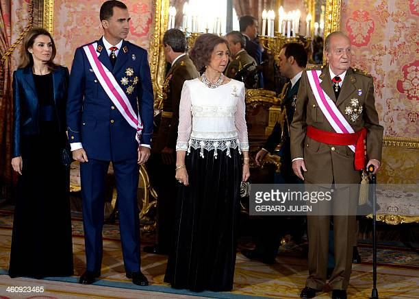 Spain's Princess Letizia, Spain's Crown Prince Felipe, Spain's Queen Sofia and Spain's King Juan Carlos gesture as they pose at the Royal Palace...