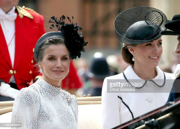 Spain's Queen Letizia and Britain's Catherine Duchess of Cambridg leave from St George's Chapel after attending the Most Noble Order of the Garter...