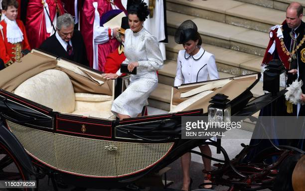 Spain's Queen Letizia and Britain's Catherine Duchess of Cambridge board a horsedrawn carriage as they leave from St George's Chapel after attending...