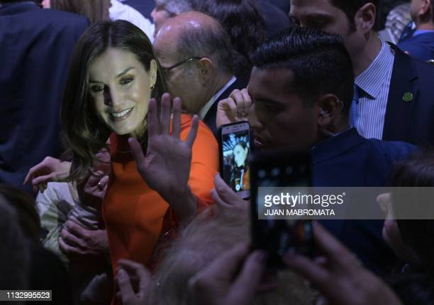 Spain's Queen Letizia greets members of the Spanish community living in Argentina after her husband King Felipe VI delivered a speech during a...