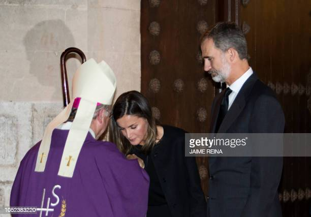 Spain´s Queen Letizia kisses the hand of bishop Sebastia Taltavull next to Spain's King Felipe VI on October 17, 2018 in Manacor after a funeral...
