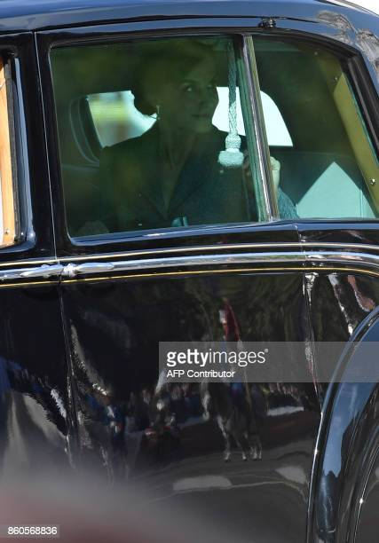 Spain's Queen Letizia looks from a car as she leaves with her husband the king after attending the Spanish National Day military parade in Madrid on...