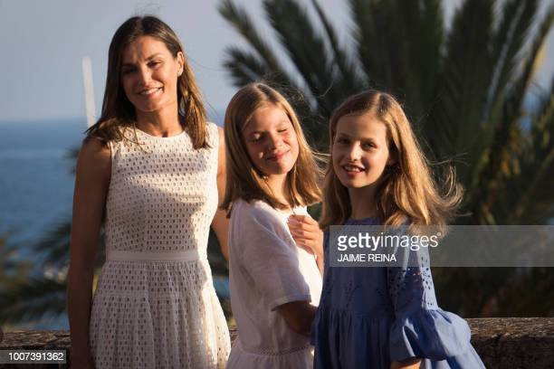 Spain's Queen Letizia poses with her daughters Spanish Crown Princess Leonor and Princess Sofia at the Almudaina Palace on the island of Majorca on...