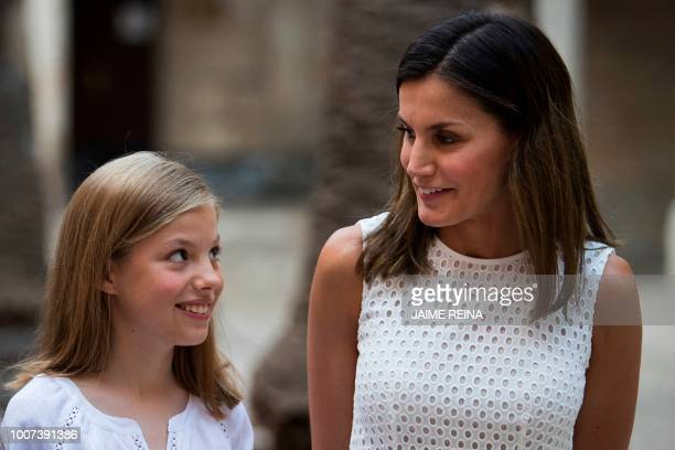 Spain's Queen Letizia speaks to her daughter Princess Sofia at the Almudaina Palace on the island of Majorca on July 29 2018 The royal family...