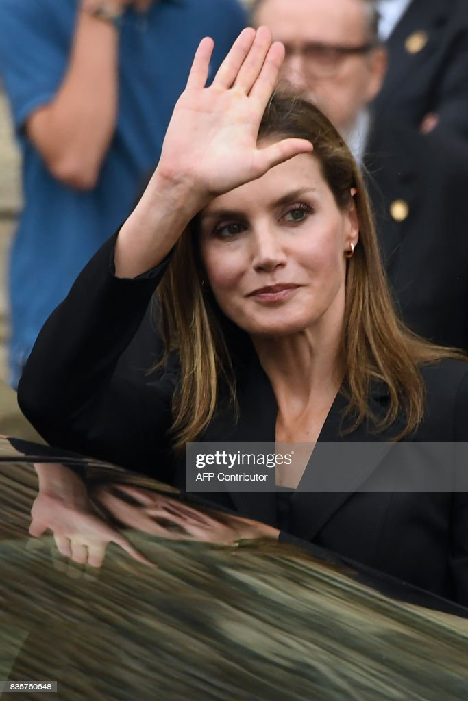 Spain's Queen Letizia waves as she leaves the Sagrada Familia church after a mass to commemorate victims of two devastating terror attacks in Barcelona and Cambrils, in Barcelona on August 20, 2017. A grief-stricken Barcelona prepared today to commemorate victims of two devastating terror attacks at a mass in the city's Sagrada Familia church. As investigators scrambled to piece together the attacks which killed 14 people in all, Interior Minister Juan Ignacio Zoido said on August 19 the cell behind the carnage that also injured 120 and plunged the country into shock had been 'dismantled,' though local authorities took a more cautious tone. GUYOT